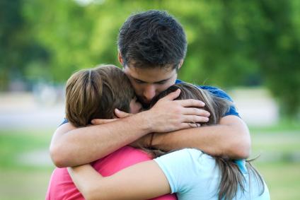 Group hug at Funeral